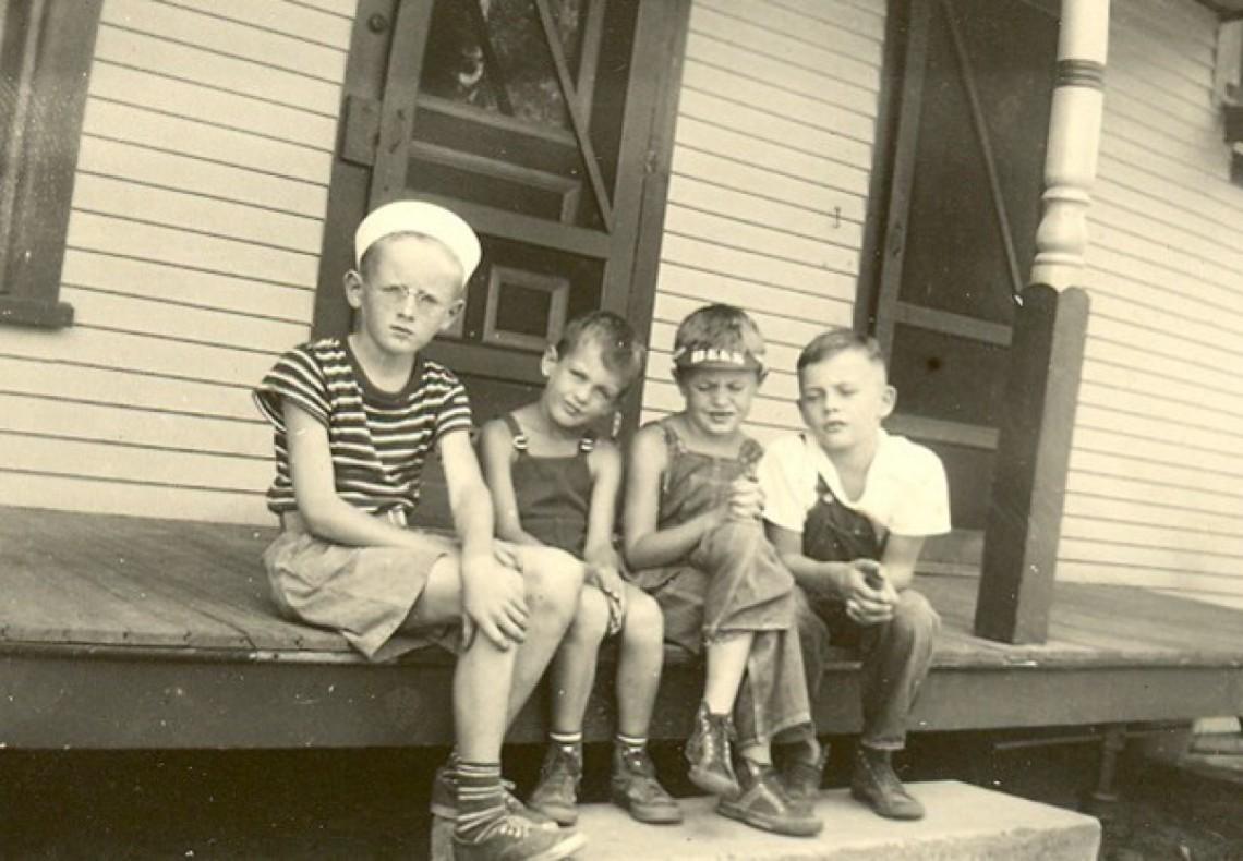 cropped-four-boys-on-a-porch.jpg